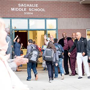 Scholars being welcomed by staff at Saghalie Middle School